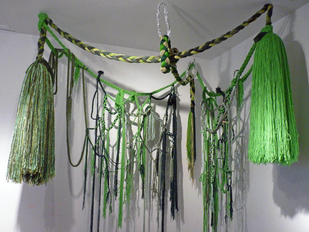 Green Piece, 2011, Acrylic yarn and tin foil, 7' x 8' x 9' (Studio view)