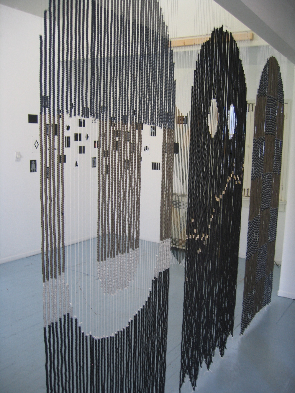 "Rico Gatson and Ellie Murphy, Pac Man at ACP, 2009, Beads, nylon, wood, hardware, Gaffers tape, paper, paint, pencil, glitter and images, 5 curtains, each 30 x 80"" (Installation detail)"