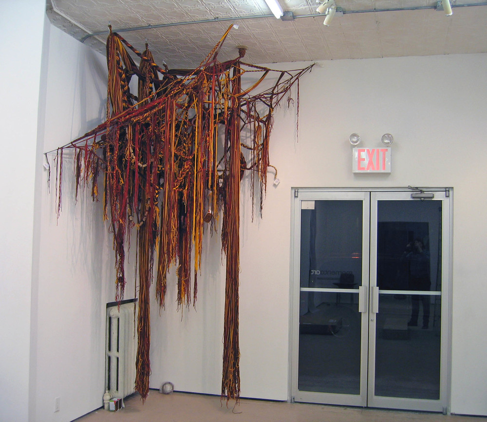 Indian Corn, 2007, Acrylic yarn, clay, cork, fabric, bamboo and cans, 7 x 6 x 11' (Installation)