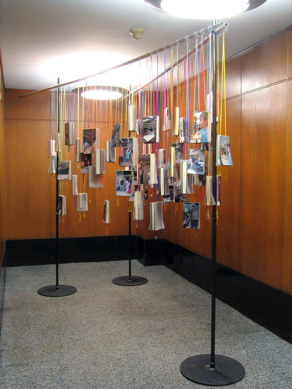 bioGRAPHY: A Site Specific Project for the Brooklyn Public Library, 2005, 60 library books, paper, photo, yarn, tape and metal, 7 x 4 x 11' (Installation view)