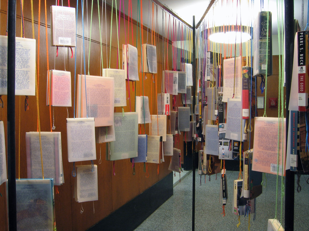 bioGRAPHY: A Site Specific Project for the Brooklyn Public Library, 2005, 60 library books, paper, photo, yarn, tape and metal, 7 x 4 x 11 feet (Detail)