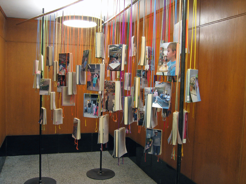 bioGRAPHY: A Site Specific Project for the Brooklyn Public Library, 2005, 60 library books, paper, photo, yarn, tape and metal, 7 x 4 x 11' (Installation)