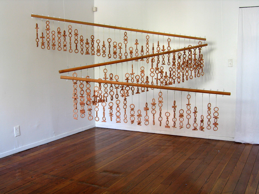 """In the beginning was the Word..."" (Binary Triptych), 2001, Clay, metal and wood, 1 1/2 x 6 feet, 1 1/2 x 7 feet, 1 1/2 x 8 feet"