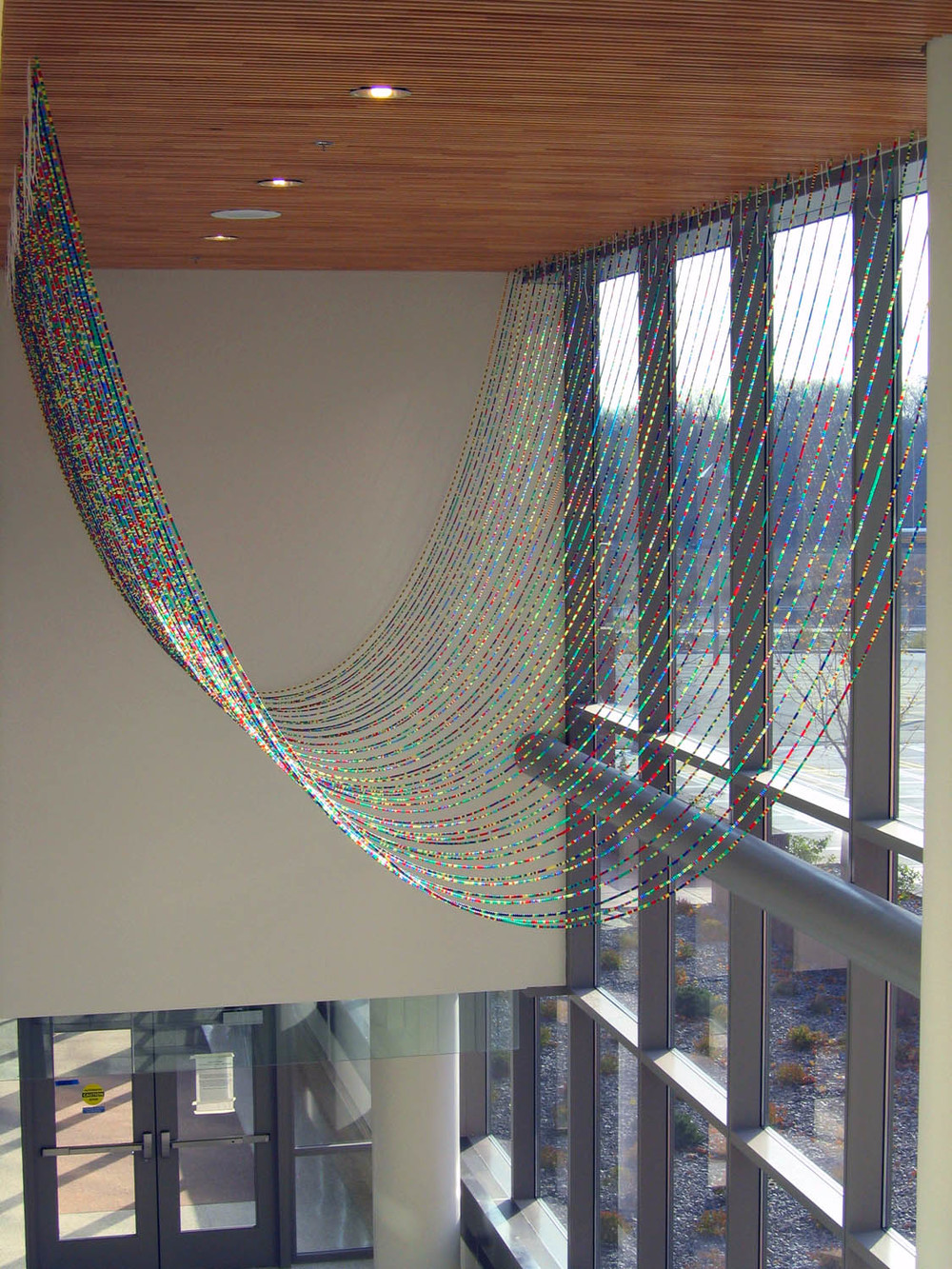 Gene Pairs ... With Ellipses, 2003, Plastic pony beads and nylon string, 35 x 25' (Installed at the Bureau of Criminal Investigation in Minneapolis, MN)