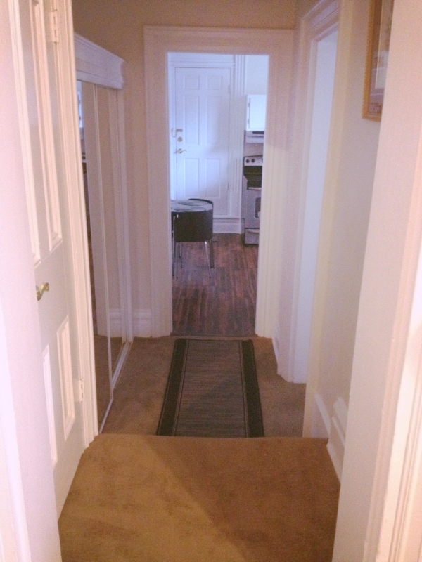 Hallway to Bathroom and Full Kitchen