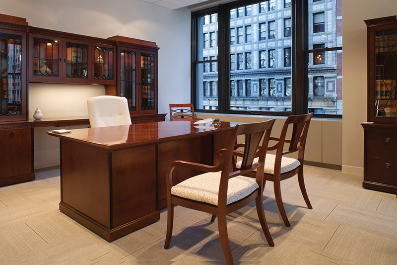 Innsbruck executive desk with storage, Muirfield desk chair, and Innsbruck and Osterley Park splat back guest seating