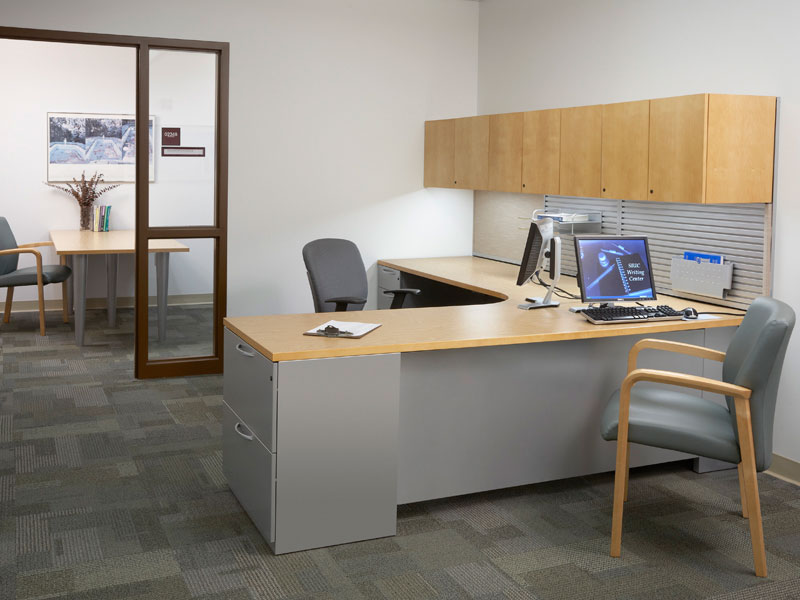 Private office with Footprint worksurfaces and storage, Wish task seating, and Stature guest seating