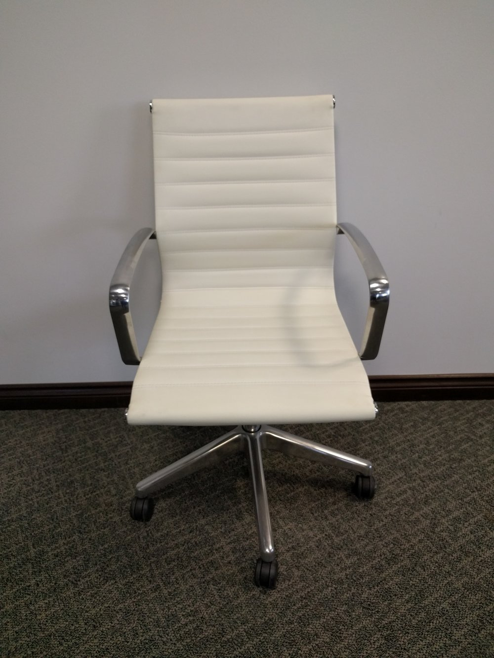 white leather task or meeting chair