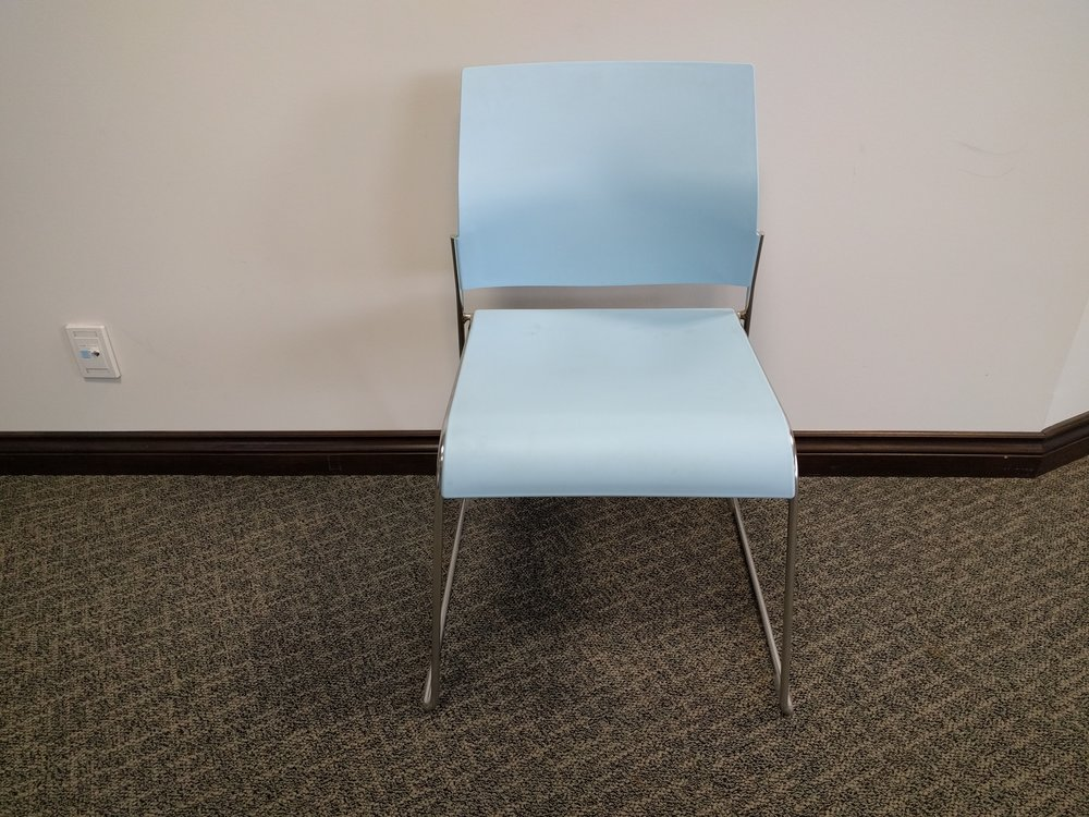 tuck poly guest chair