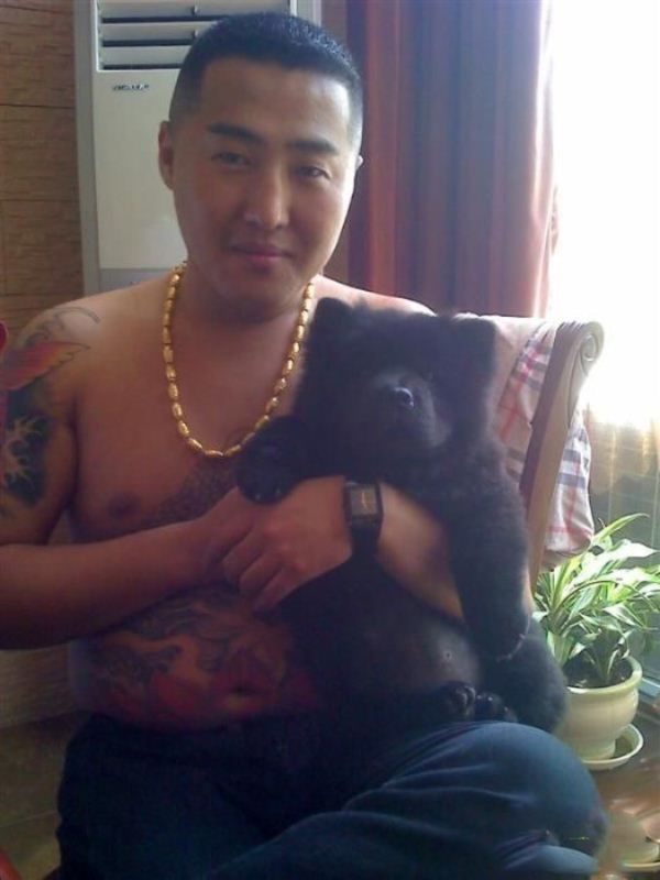 Chinese Gangster  phone pics  leaked onto internet.