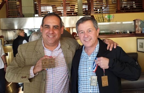Longtime friends, Chris Madrigal and Rudy Von Strasser, show off their Gold Medals at the American Fine Wine Competition in true Olympic spirit.