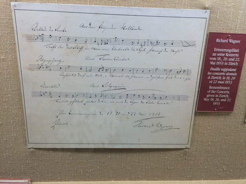 "Wagner created this remembrance card for his concerts in Zürich featuring his operas with his 3 ""hit tunes."" For instance, you can read the famous Bridal March from Lohengrin on the third line."