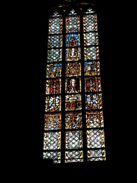 The stained glass window featuring JSB