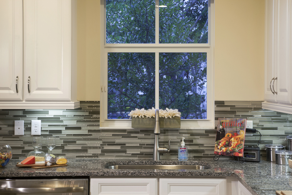 A glass tile back splash is a beautiful kitchen detail.