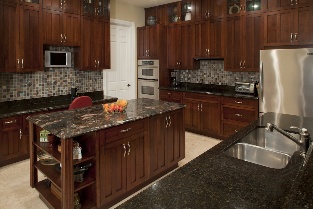 Rich dark wood cabinetry make an elegant touch.