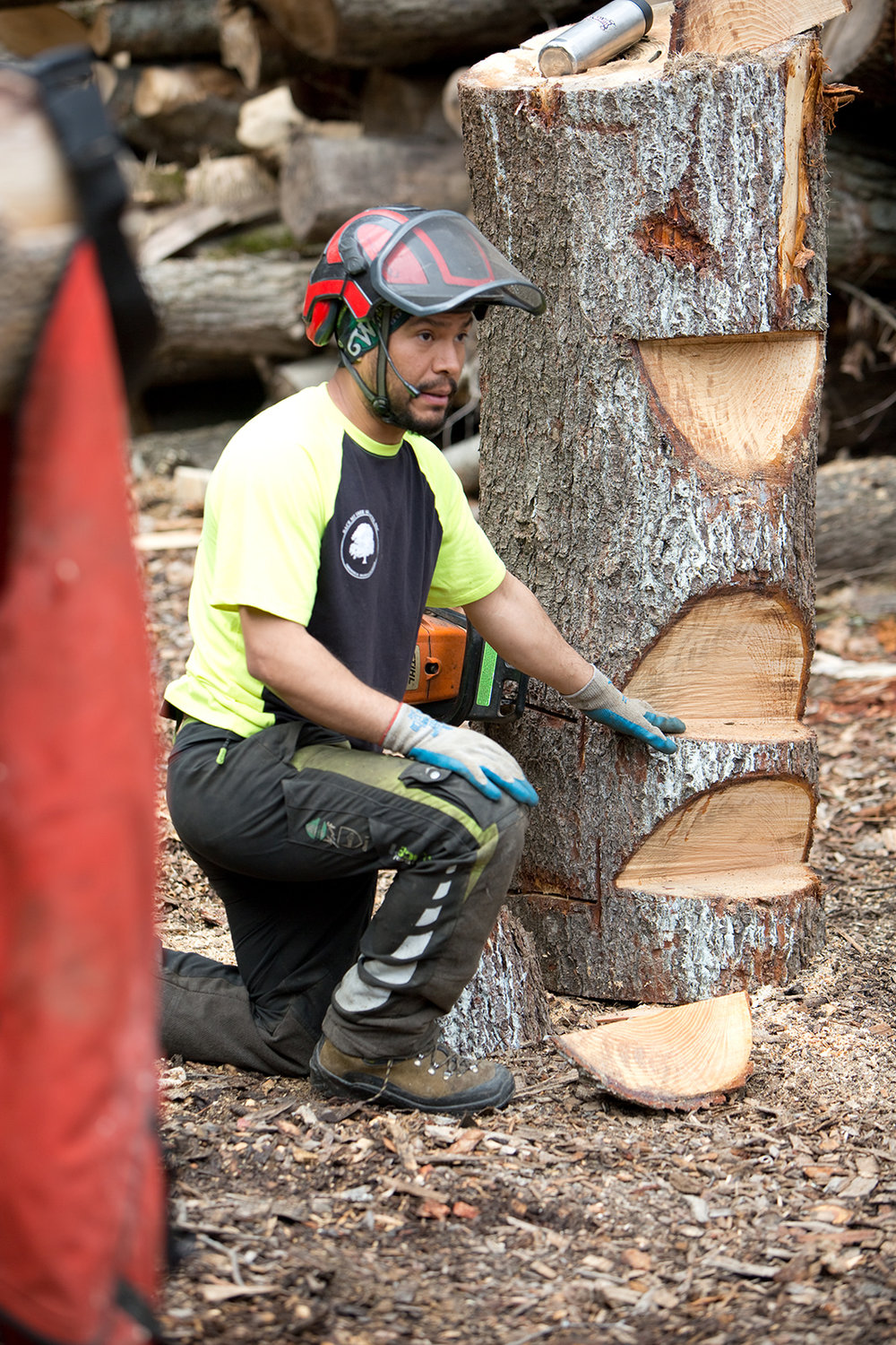 Marco Benitez demonstrates different chainsaw cuts.