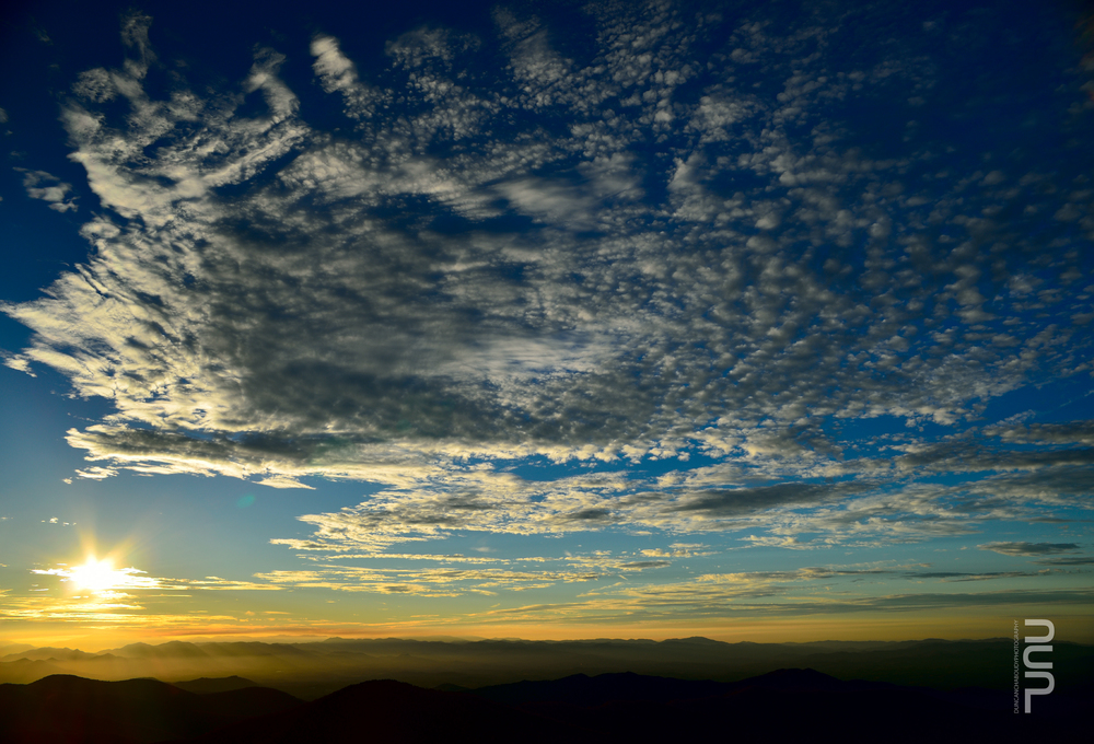 Looking towards the sunset from Craggy Pinnacle at Blue Ridge Parkway, North Carolina.