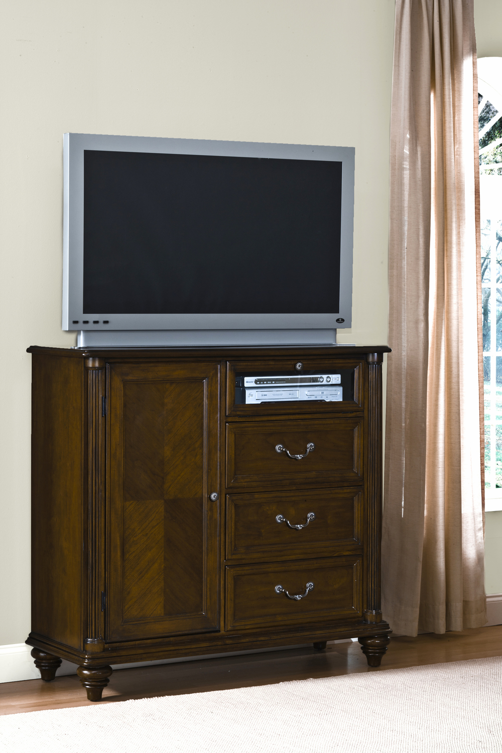 Entertainment furniture with a door, three drawers and open space for electronics