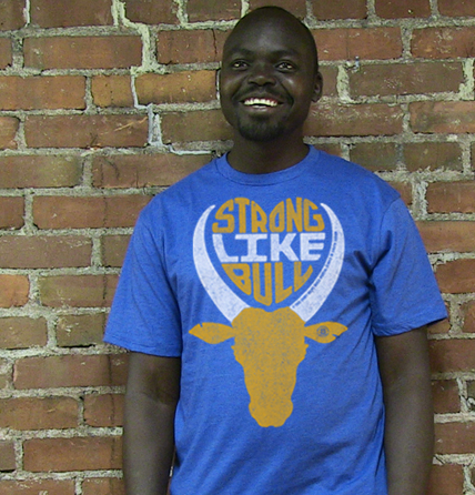 Achier posing in VT in his Strong like Bull tee before returning to S. Sudan to start a maternal health clinic and train local nurses.