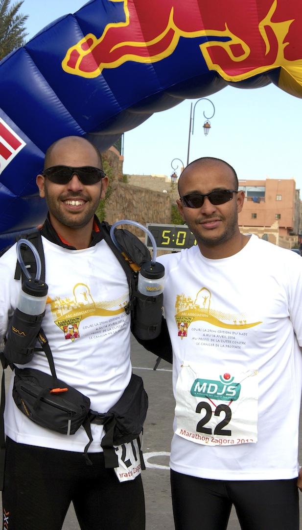 Sidi-Mohammad Rahhaoui & Nabil Abza finish line Zagora Marathon 2013.jpg