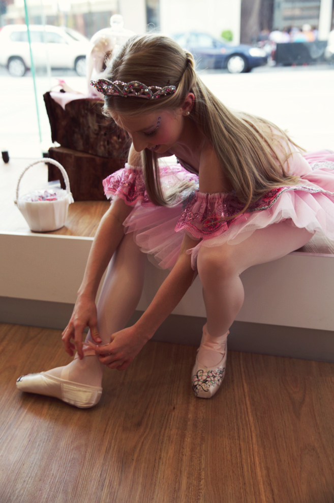 Our beautiful fairy Blossom slips her pretty blossom pointe shoes on before greeting everyone at our Ivanhoe Store opening! :)