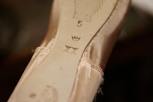 """The maker's mark of """"Crown"""" upon the sole of one of his pointe-shoes."""