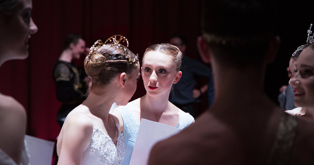Genée 2016 Gold Medalist Maeve Nolan shares a moment with a fellow competitor during the day.