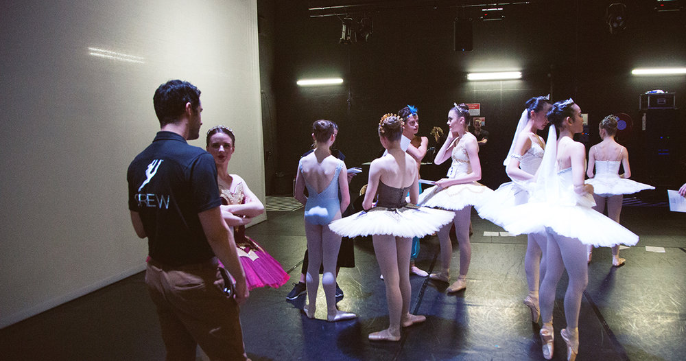David Williams talking backstage to some of the Genée's young candidates.