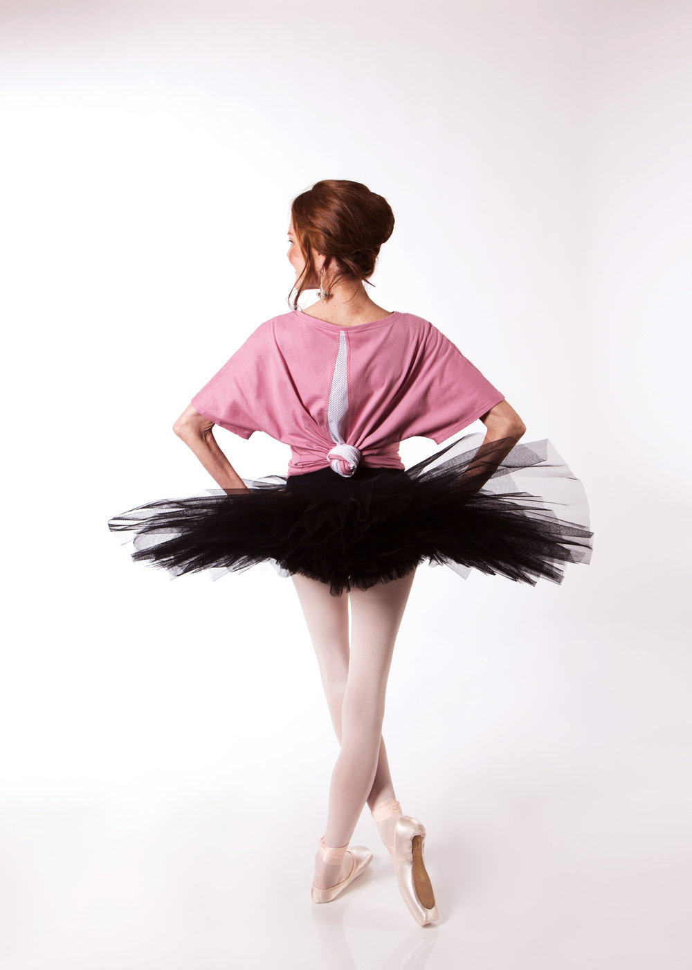 Carol wears a  Half Tutu  in Black, with the  Grace Detailed Back Tee  in Dusty rose and Energetiks  Sapphire  Pointe Shoes