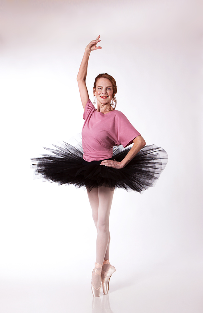 Carol wears a  Half Tutu  in Black, with the  Grace Detailed Back Tee  in Dusty Rose