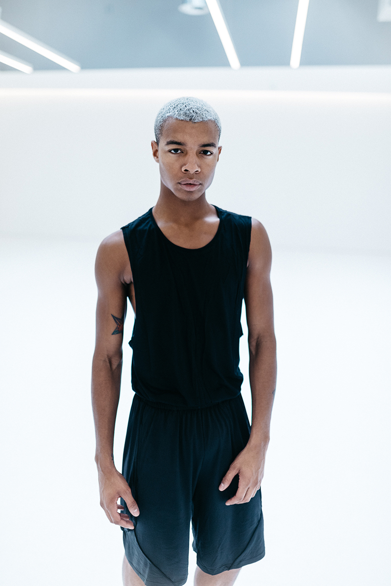 Louis wears the  Urban Short  and  Low Back Singlet  in Black
