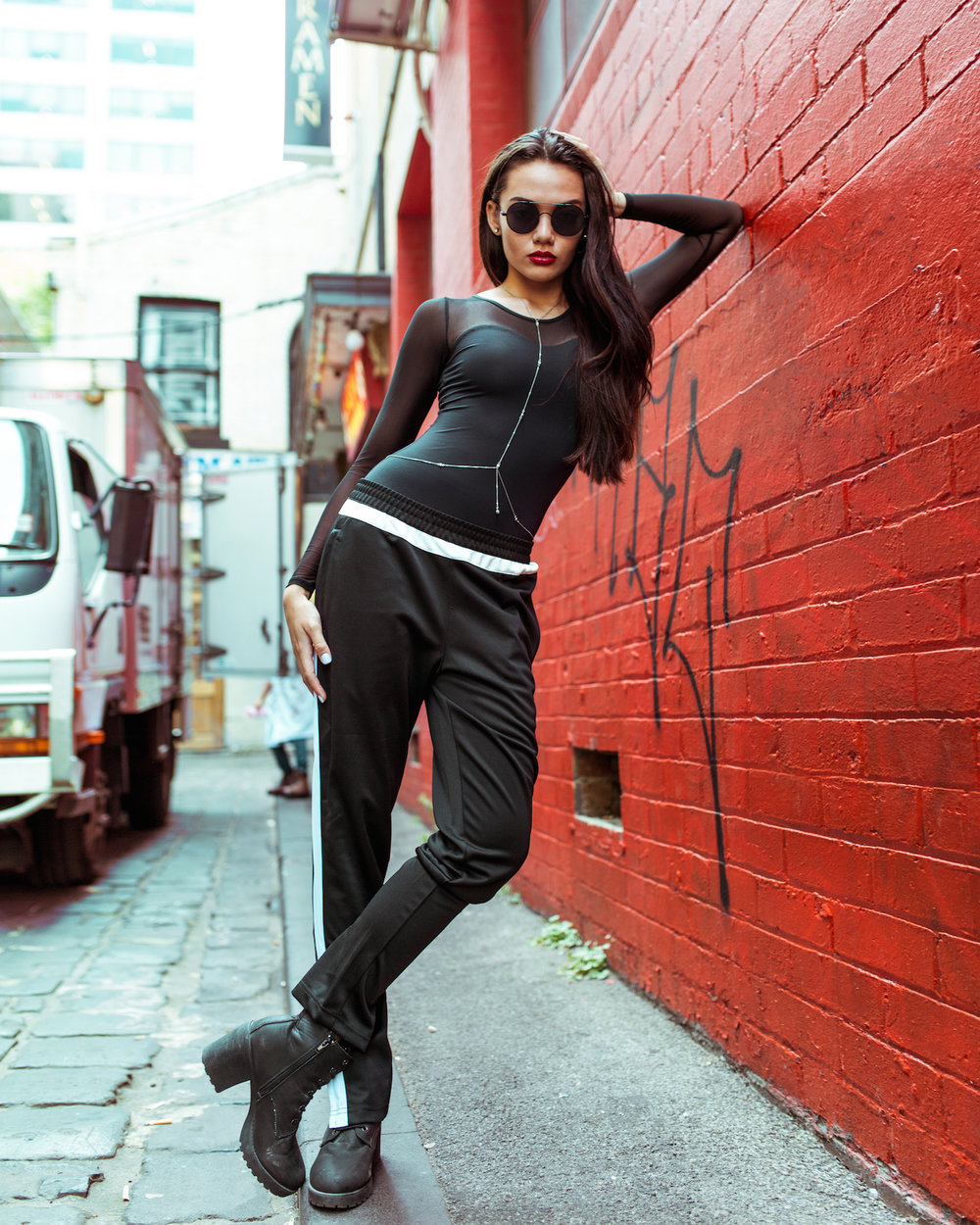 Portia wears: Energetiks  Maya Leotard  in black, and black Track Pants.