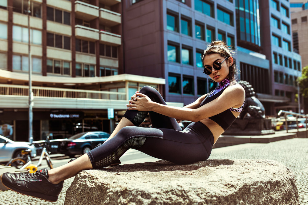 Portia wears: Energetiks  Ivy Crop  in Florise,  Eve Crop  in Black and  Stella Legging  in black.