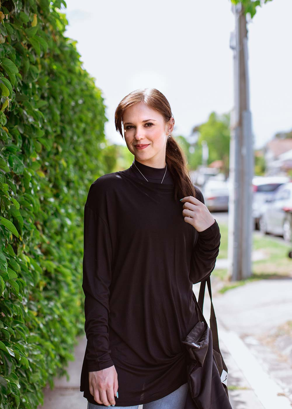 Amy wears the  Aubrey Knot Long Sleeve Tee  from the  Atelier Collection , the  Ivy Crop , and carries the  Dance Tote