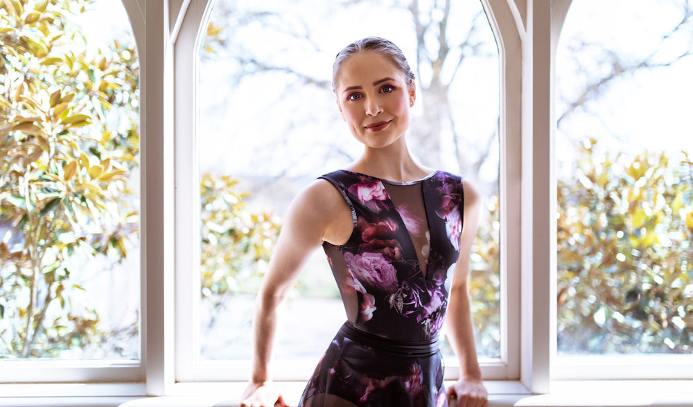 Alex wears the Energetiks  Dawn Leotard  and  Melody Skirt  from the Aria Collection