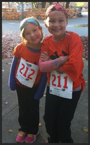 kids-running-gear-on-at-the-beach-america-headbands-Pumpkins-in-background-NH.jpg