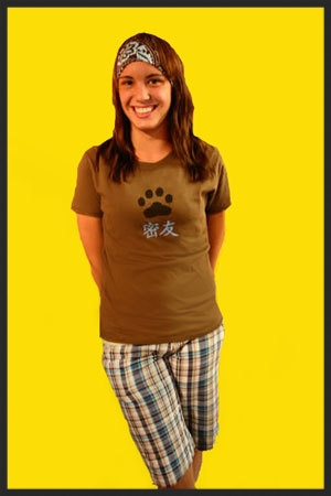 model-fan-girl-maine-brown-moxie-shirt-headband-yellow-background.jpg