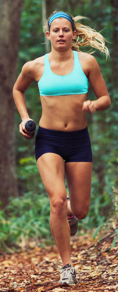 Girl running through the woods with a Blue Cooling wicking Headband sweatband