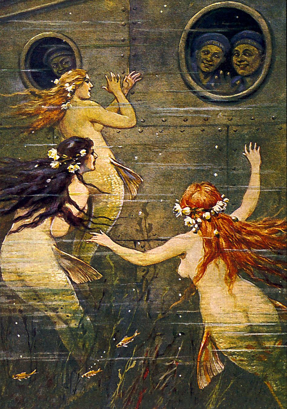 Three mermaids waving at sub crew.