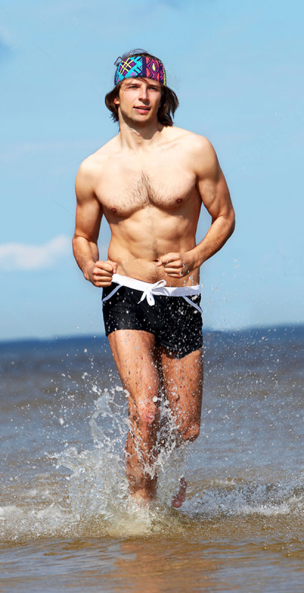 Beach Boy Running in the water with surf with southwest style fabric headband