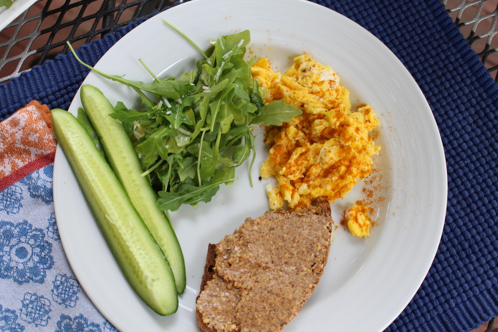 After my walk I made myself eggs with turmeric and pepper, toast with almond butter, sliced cucumbers, and an arugula salad with EVOO and lime juice.