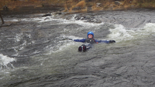 The whitewater simmers position is a simple and effective way of minimizing risk while swimming a rapid.  Photo courtesy of Frontier Bushcraft