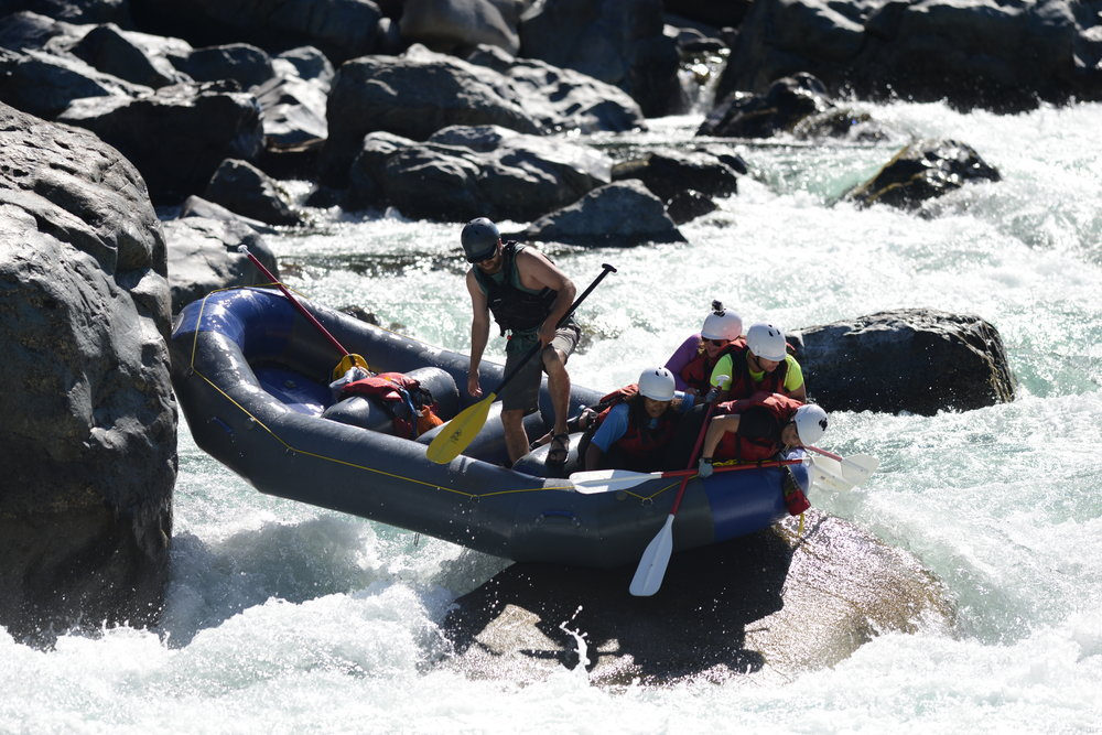 Triad Guide Blake Henderson demonstrates just how durable an Aire Tributary raft is while running Boulder Drop on the Skykomish River during the low water of the drought riddled 2015 season.