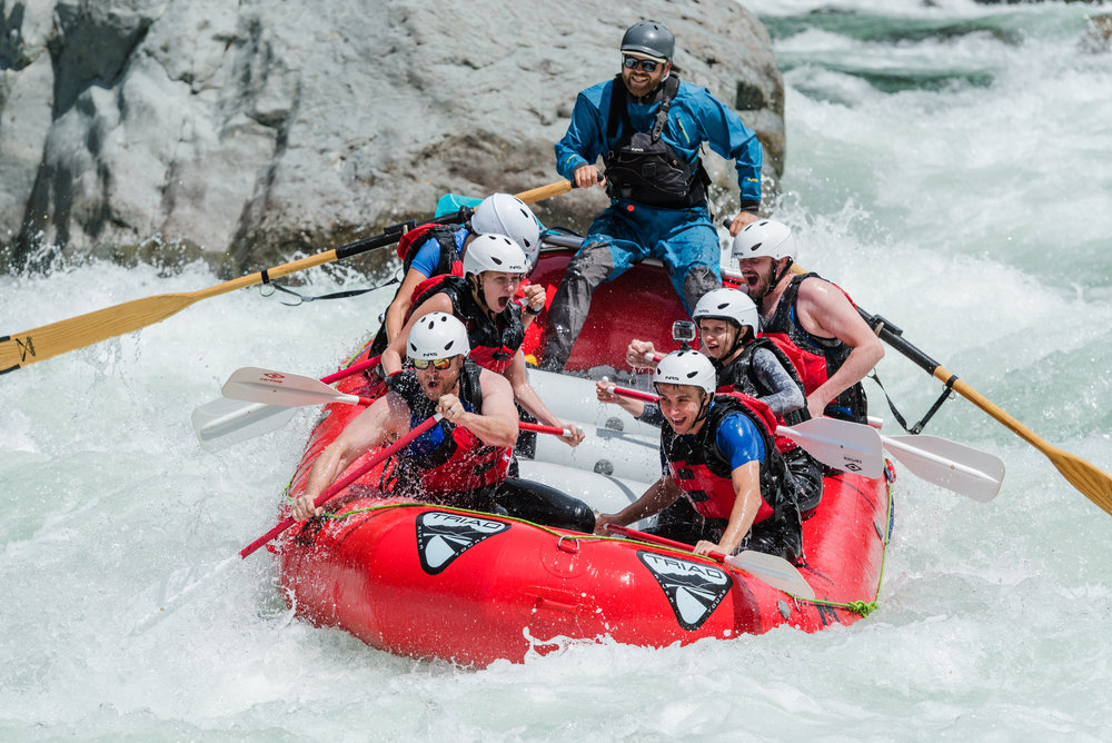 A group of rafting guests of Triad River Tours on the Skykomish River near Seattle Washington