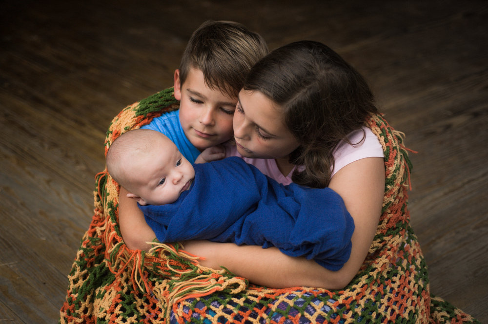 Siblings Portrait with great Grandmother's blanket