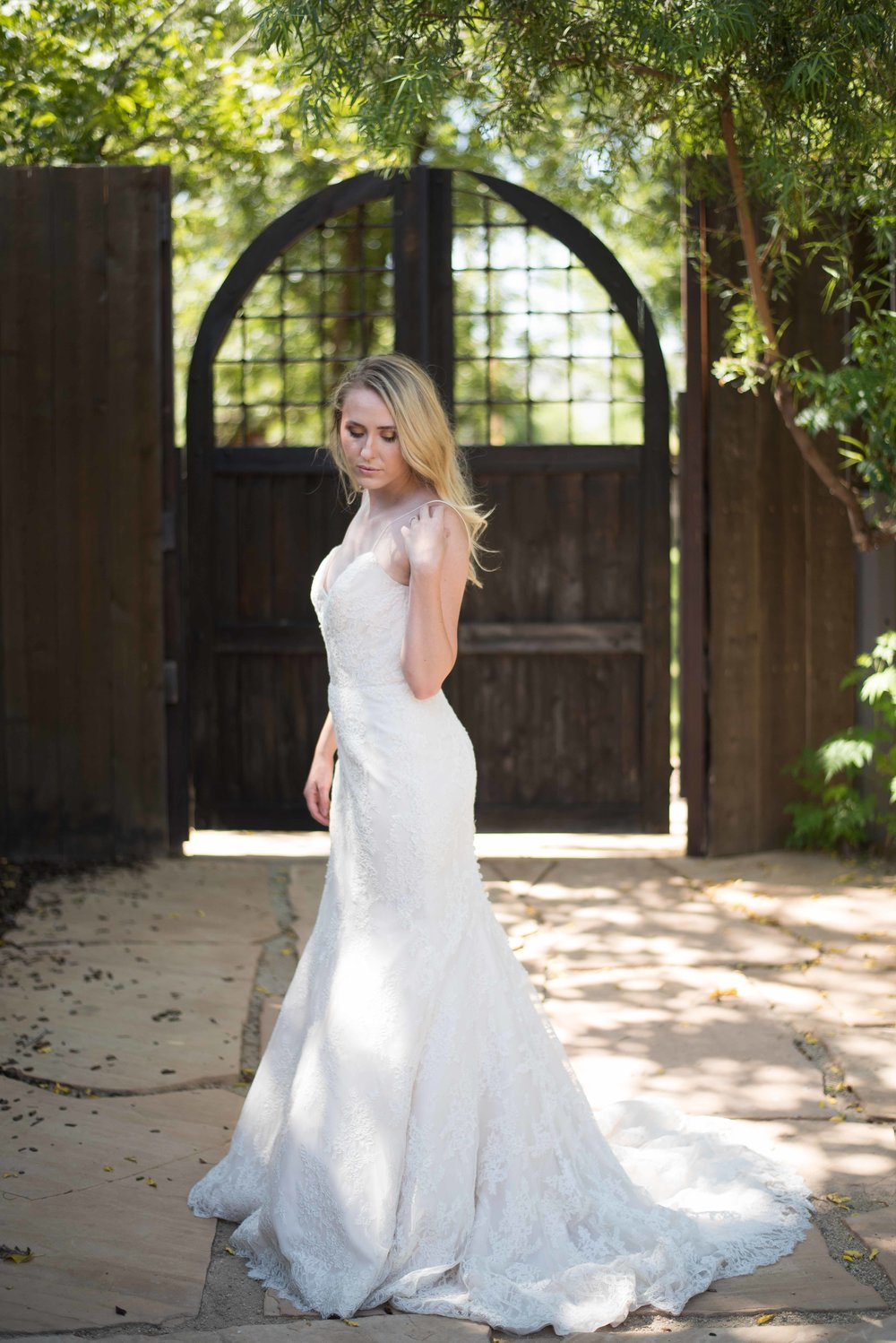 Yosemite - This traditional, yet breathtaking dress is a Bliss Monique Lhuillier dress. This dress fits best a curvy size six. This dress rents for $250.