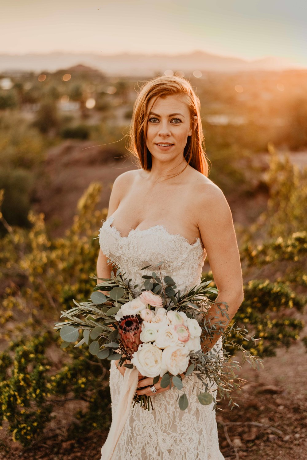 Olia Zavozina Wedding Dress for Rent! - New to the collection of dresses I offer to rent for my elopement and intimate wedding brides is this stunning Olia Zavozina dress! She's a beauty with lace and jewels with a sexy cut. The dress is a size ten, but fits more like a 2-4 with a C - D cup size. The dress also offers support with a built in bra structure. As you may know all of my dresses are named after National Parks. The people spoke (aka fans on Facebook) and this dress will be named Glacier! This dress will be available for rent at the price of $300 and you can alter the dress to fit your curves perfectly if needed!Why rent your dress?Renting your dress is a great choice for so many reasons!! It is a great way to save money in the ever expensive wedding industry, but it is also so much more than that! Renting your wedding dress is an eco friendly move. The stats are all out there with a simply Google search of how much waste is created from one wedding. Renting your dress leaves one less dress made or you could also purchase a more eco-friendly made dress by materials like bamboo. By renting and not buying you are also saving yourself some closet space for in the future!! After your wedding you will have all the images in the world to keep your memory of the dress around, why let it sit in your closet for decades collecting dust? Lastly, as an elopement bride renting your dress is fantastic! It is less you have to worry about getting from point A to point B if you are traveling to your elopement location. Also, most elopement brides are climbing mountains or like here in the desert you're trekking around in the red dirt. The dress will get dirty! By renting you do not have to worry about this being an concern on your big day!Interested in a dress or more information?? Contact me!