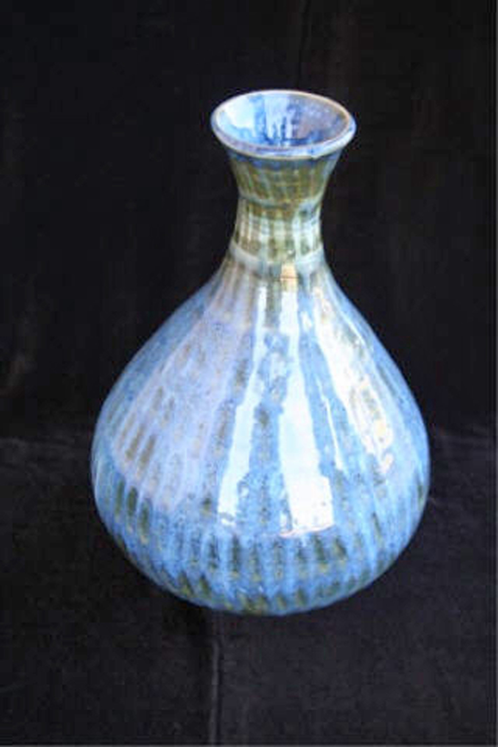 "Blue Ripples  , 2007, wheel-thrown stoneware Fired at cone 6 oxidation, 9 1/4"" h x 6"" dia"