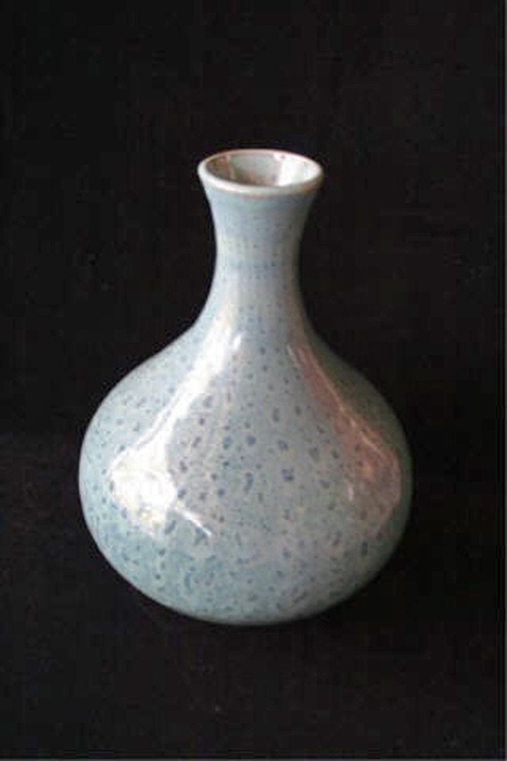 "I See Spots  , 2007, wheel-thrown bentonite clay Fired at cone 6 oxidation, 8"" h x 5 3/4"" dia Collection of Mr. and Mrs. David and Joan Black, Ontario, Canada"