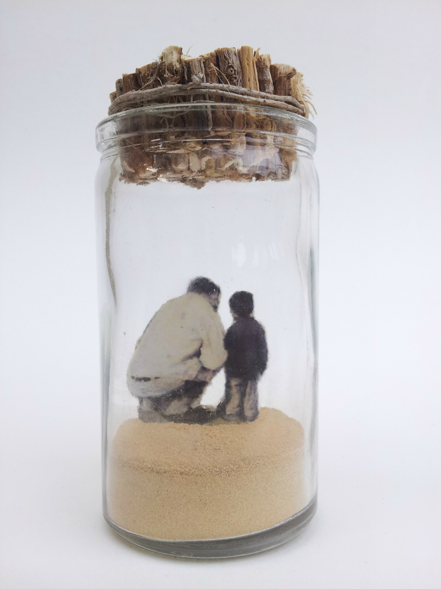 "I Wonder Whether the Stars are Set Alight in Heaven   No. 1 from  Little Princes  installation, 2014 Acrylic, ink, paper, plant roots, and sand in glass jar 4 ½"" height x 2"" diameter  Underside reads:   I wonder whether the stars are set alight in heaven so that one day each one of us may find his own again…"